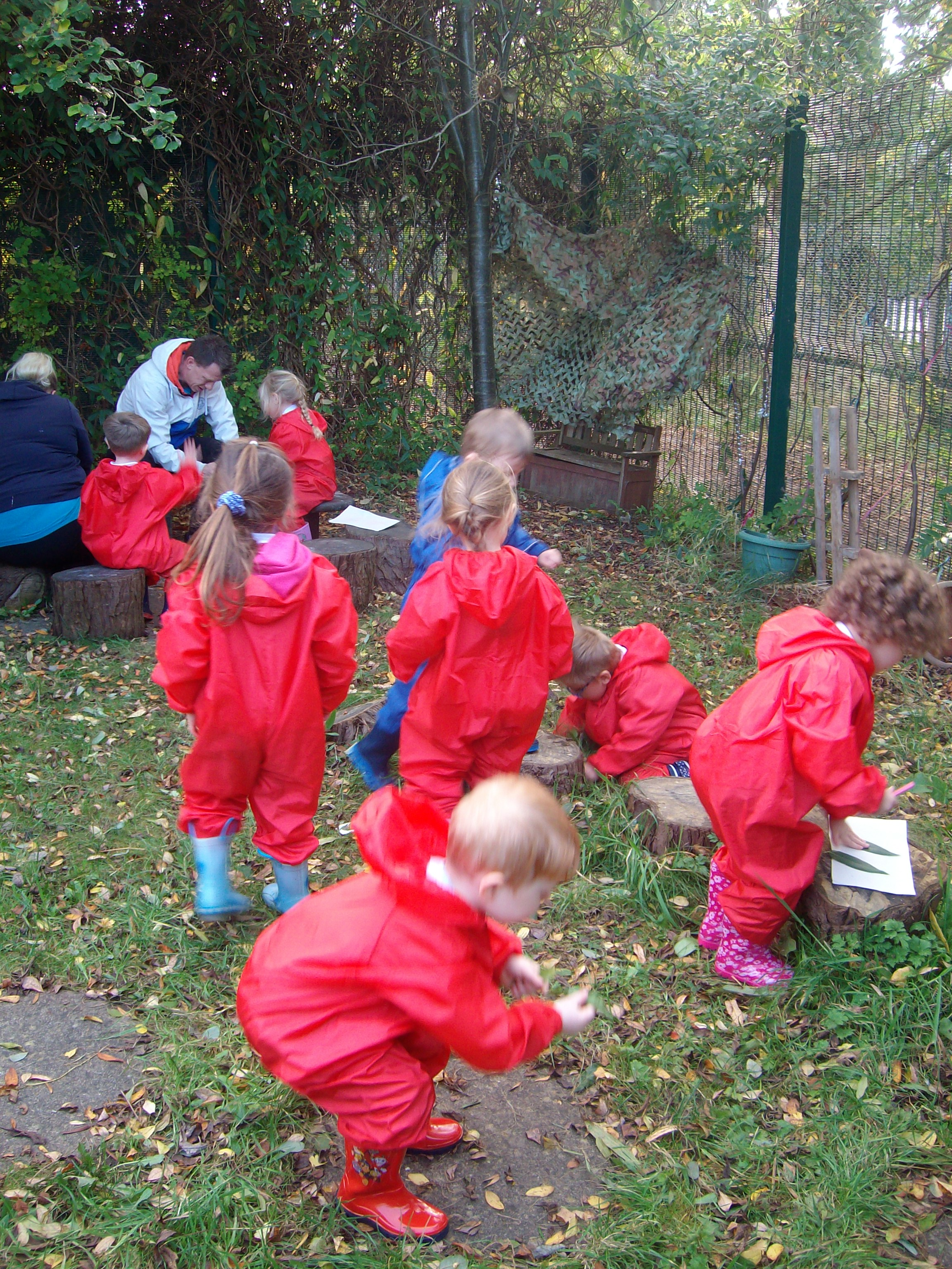 Children in red outdoor suits