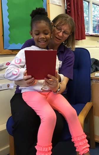 Child and practitioner reading together