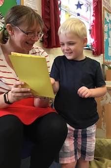 Practitioner reading to child
