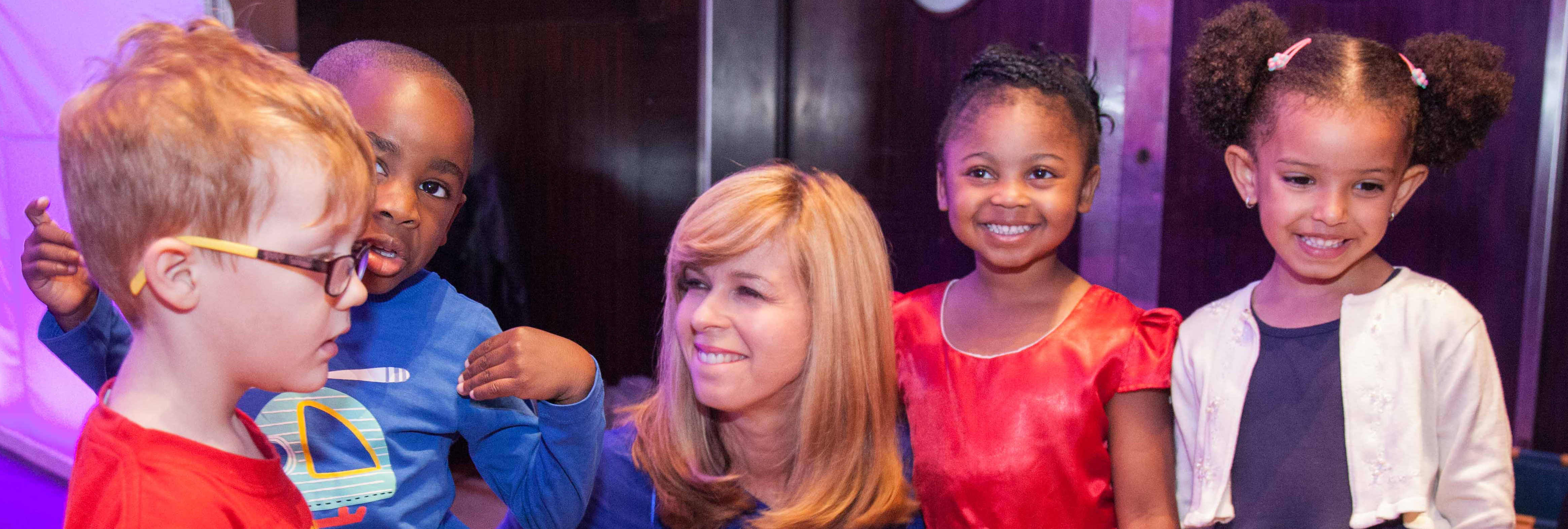 Volunteer awards host Kate Garraway with special awards helpers, 2016