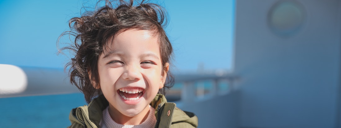 Boy laughing in the sunshine