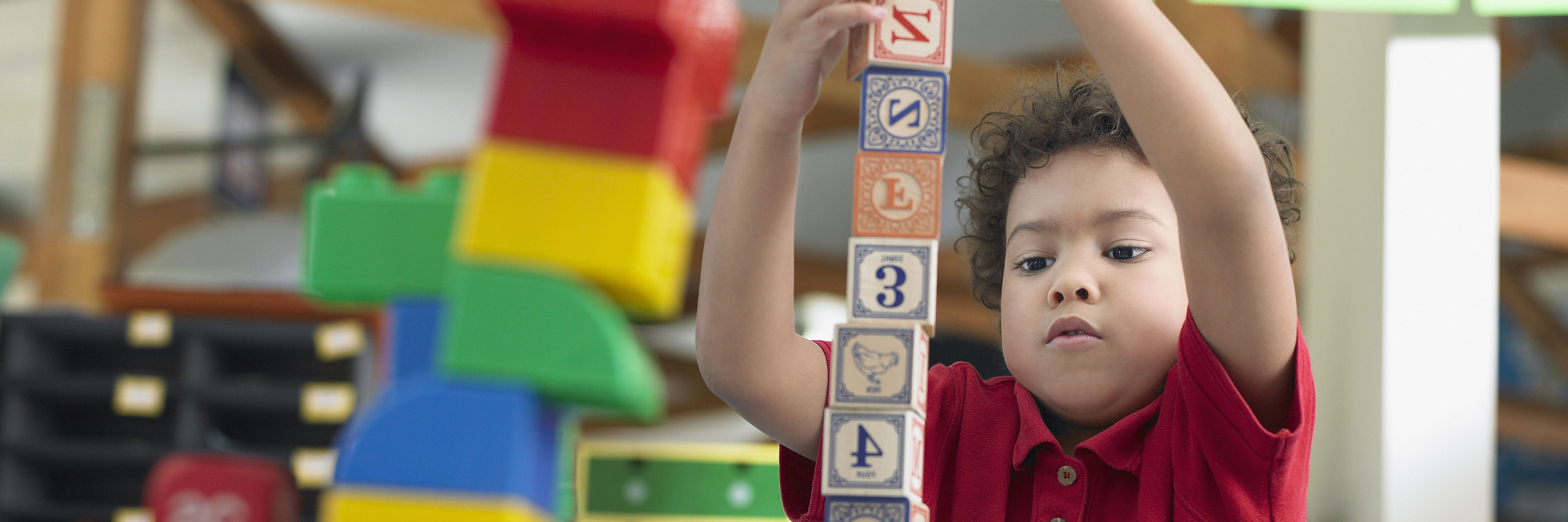 boy building blocks tower