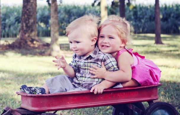 children play in wagon