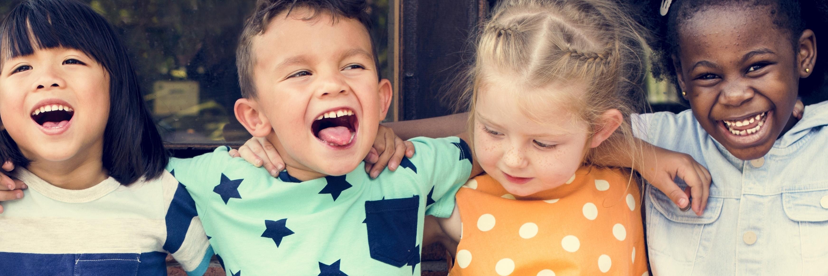 children sitting arm in arm