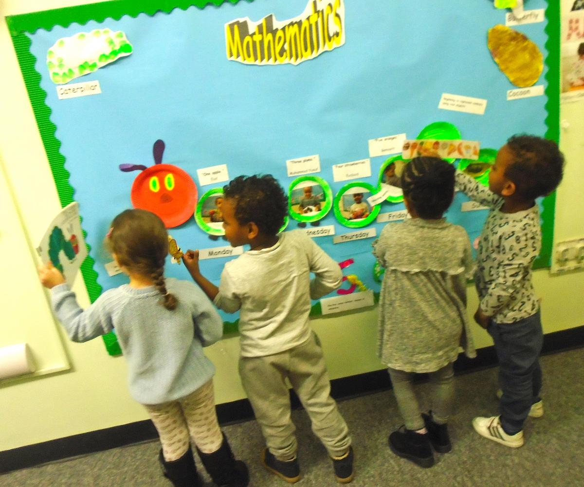 Children making a display at nursery