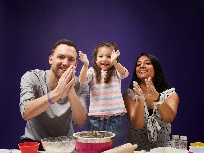 Maia, having fun baking with Mum and Dad
