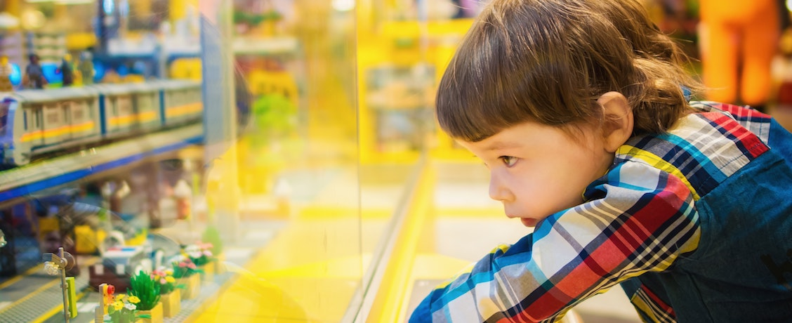 Boy looking in shop window