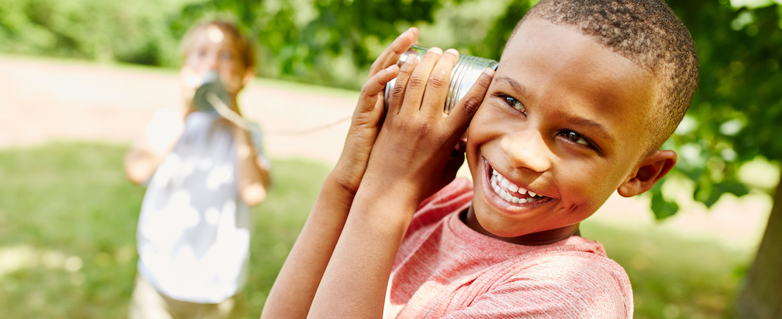 Boy with tin can telephone