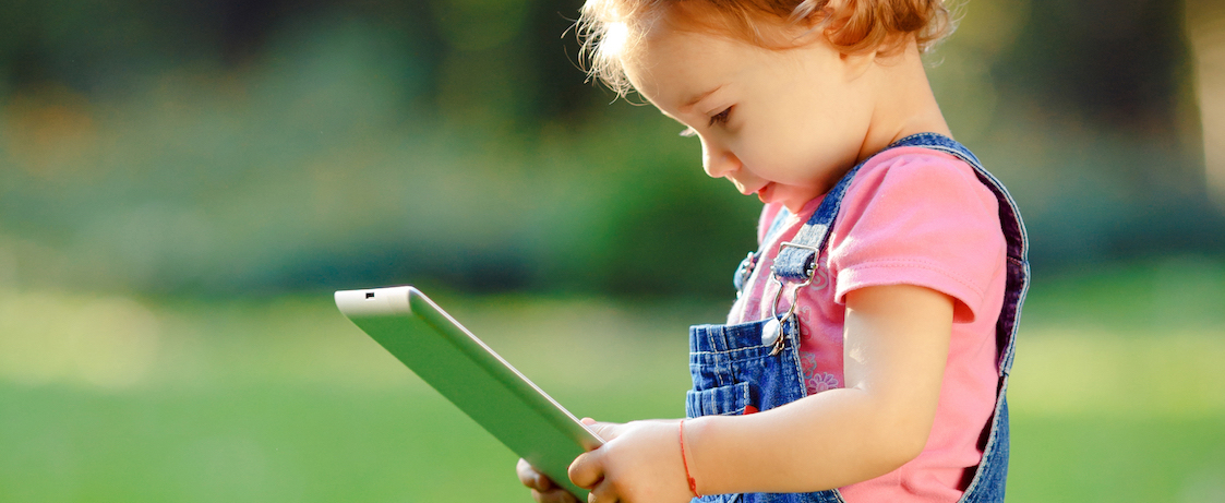 girl reading on a tablet