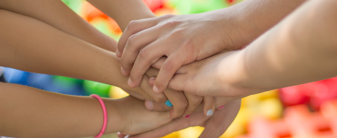Hands joining together