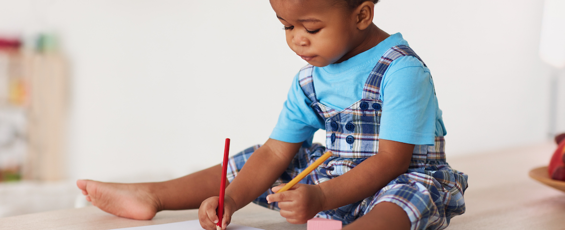 Toddler drawing on floor