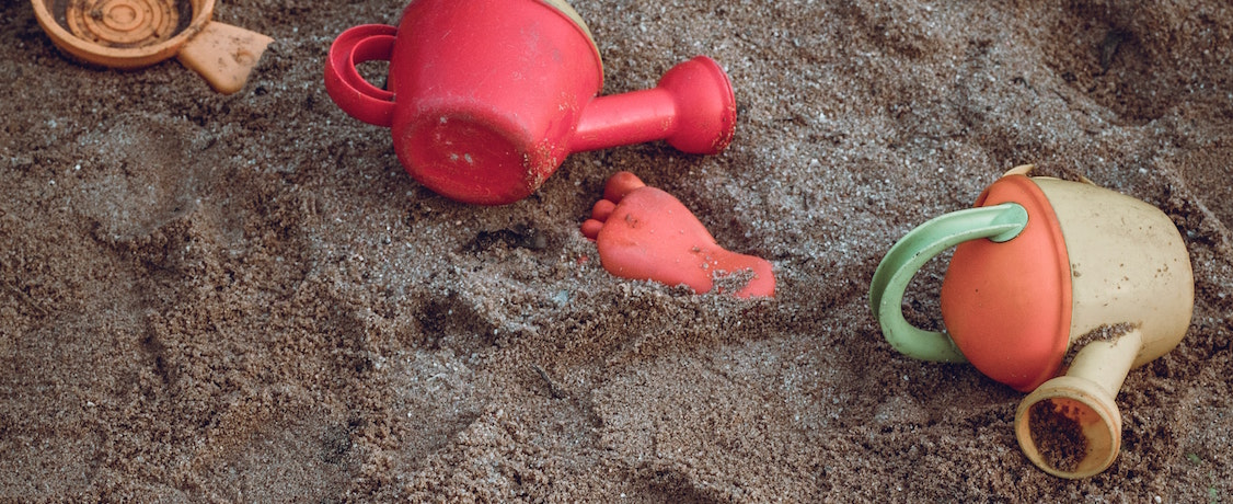 Watering can in the sand