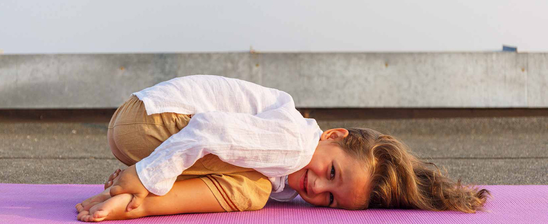 Girl lying on yoga mat