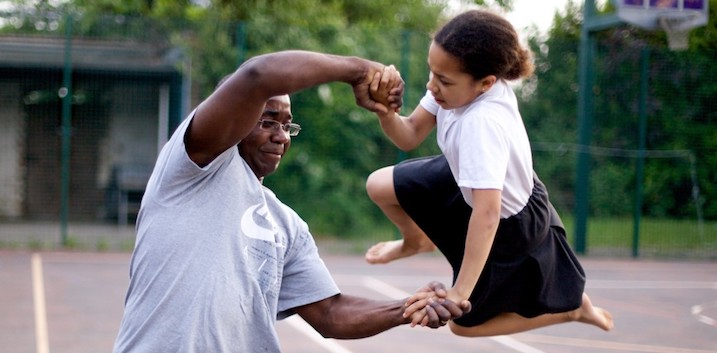 Father swinging daughter around