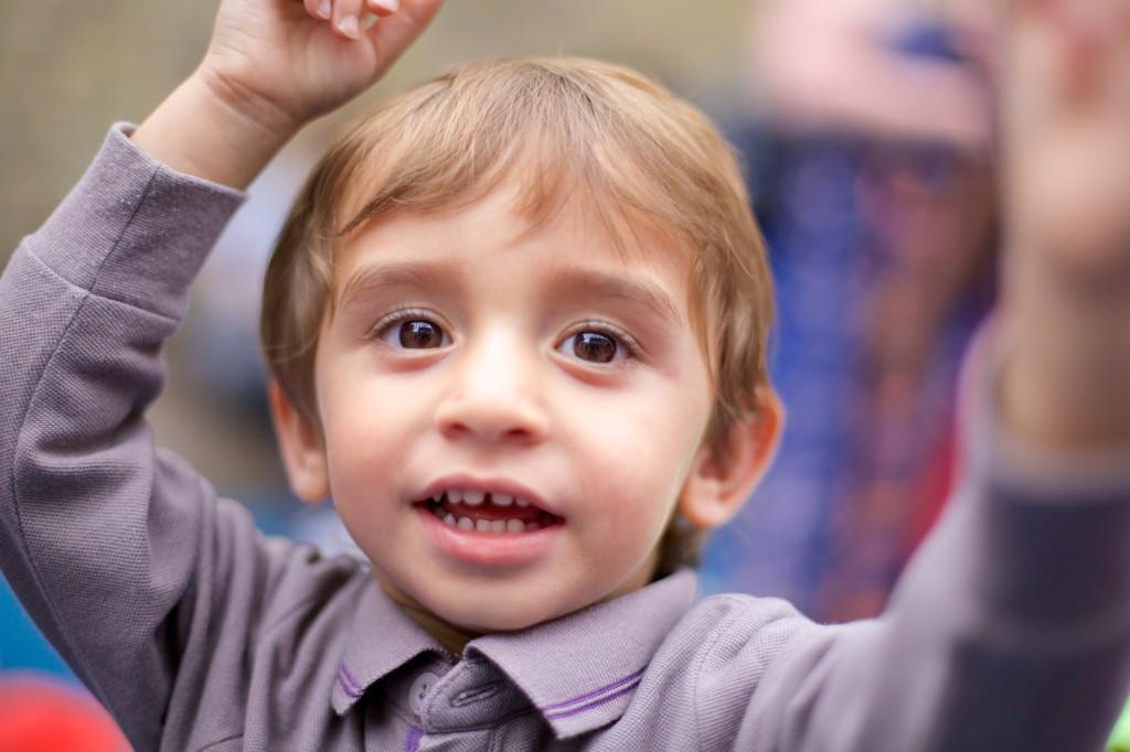 Little boy raising his hands