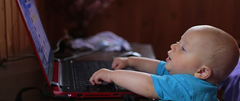 Baby tapping at a laptop