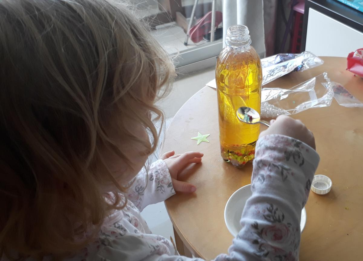 Jessica's daughter playing with sensory activity