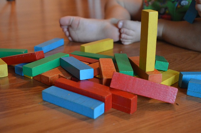 child playing building blocks