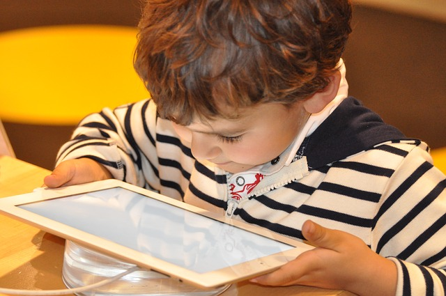 Child uses tablet - baseline assessment plans revealed