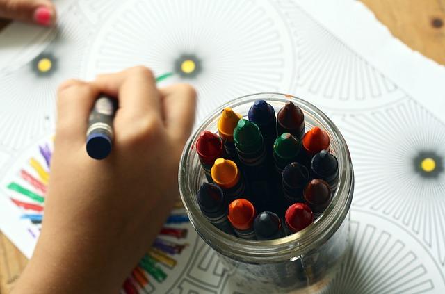 child drawing crayons