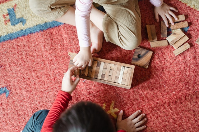 children playing Jenga EYFS Reforms