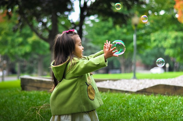 girl catching bubble