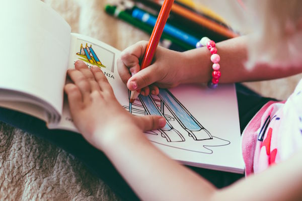 child drawing notepad
