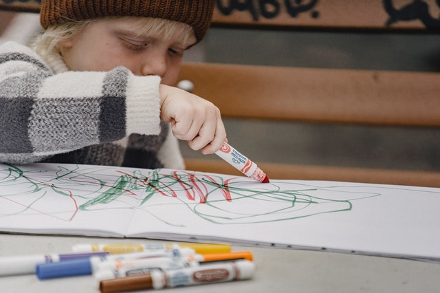 child doodling free childcare top up fee