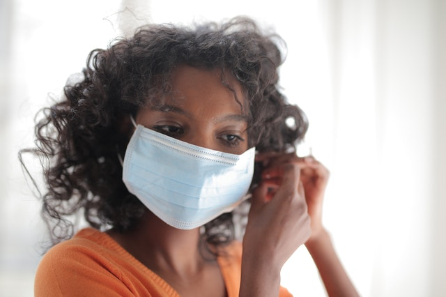 Covid-19 woman in face mask testing asymptomatic