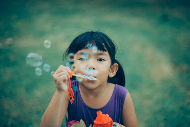 child playing bubbles