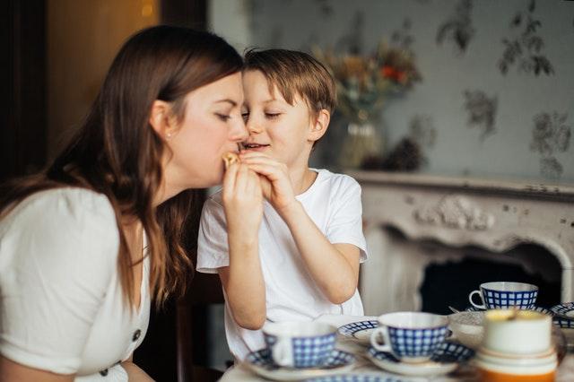 parent and child having tea wellbeing nursery staff