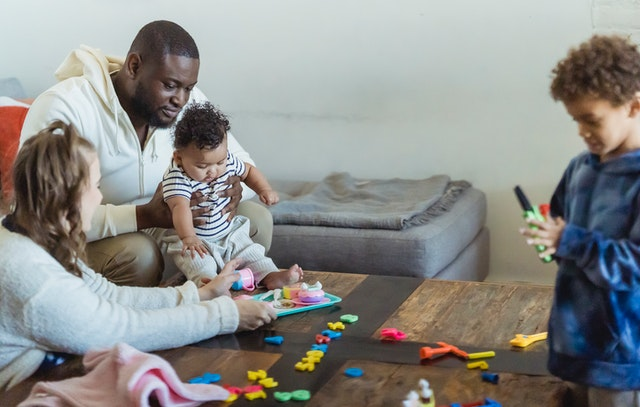family playing with young children childcare costs