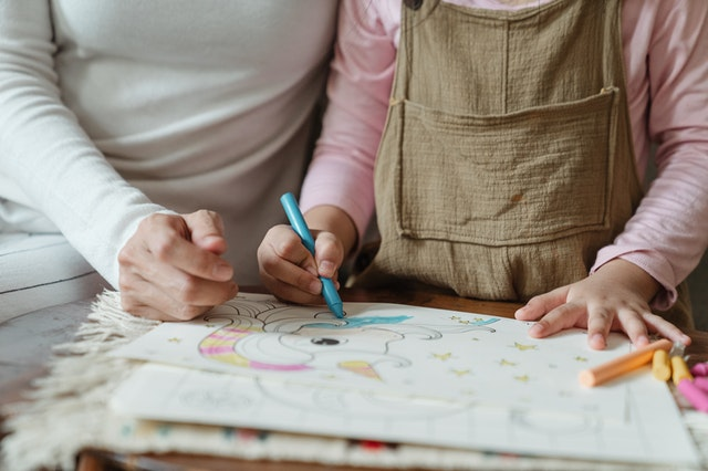 child and childminder drawing Ofsted inspections