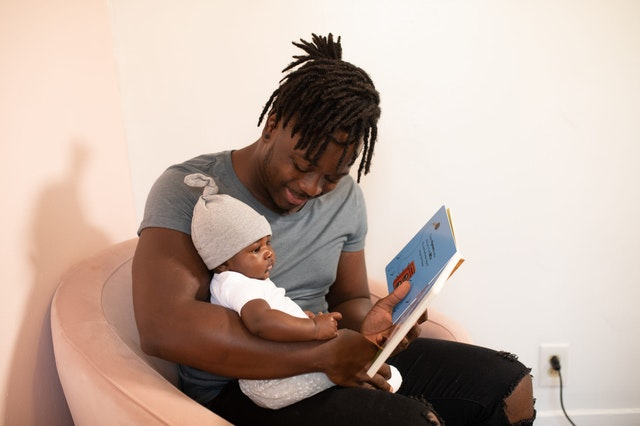 nursery staff baby reading early years