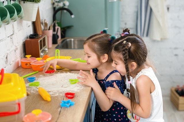 children playing baking flour