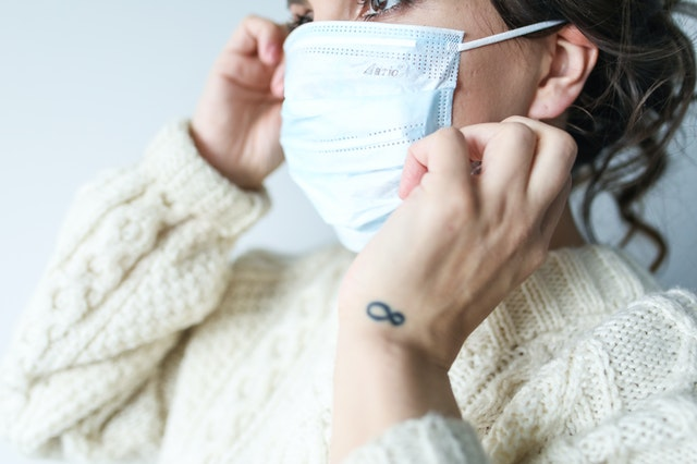 woman in face mask covid 19 nurseries childminders restrictions rules disapplications
