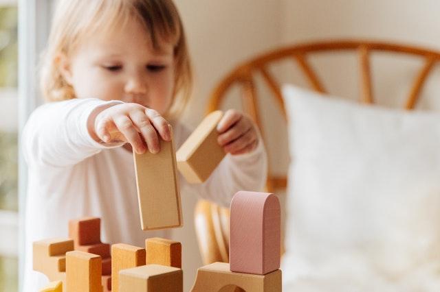 child playing blocks toys