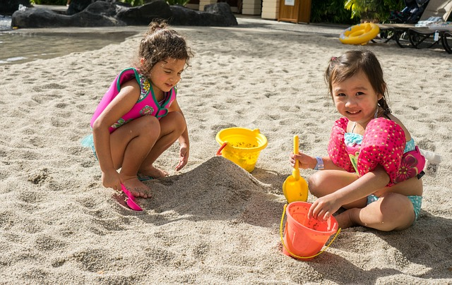 Little girls playing the sand
