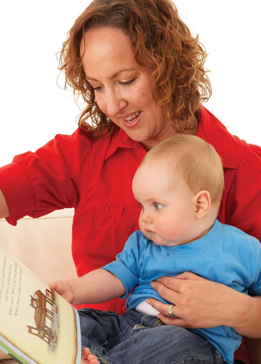 woman reads to baby