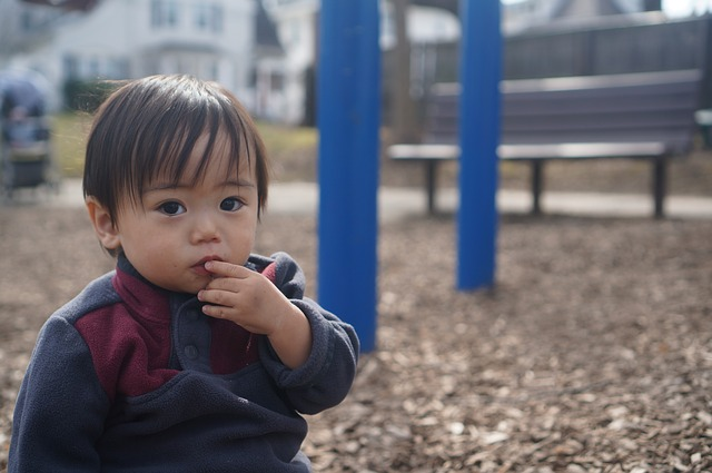 Child in playground funded childcare