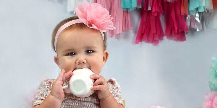 Little baby girl with tea cup