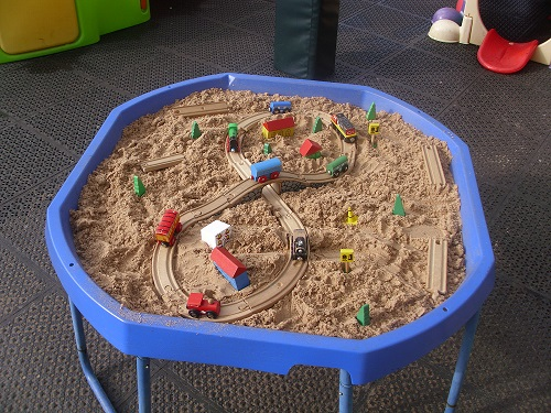 A sand tray and toys
