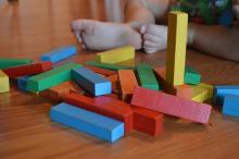 child playing building blocks