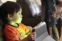 Child playing with tablet