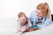 Childminder reading to a child