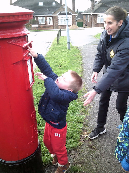 Child posting a letter