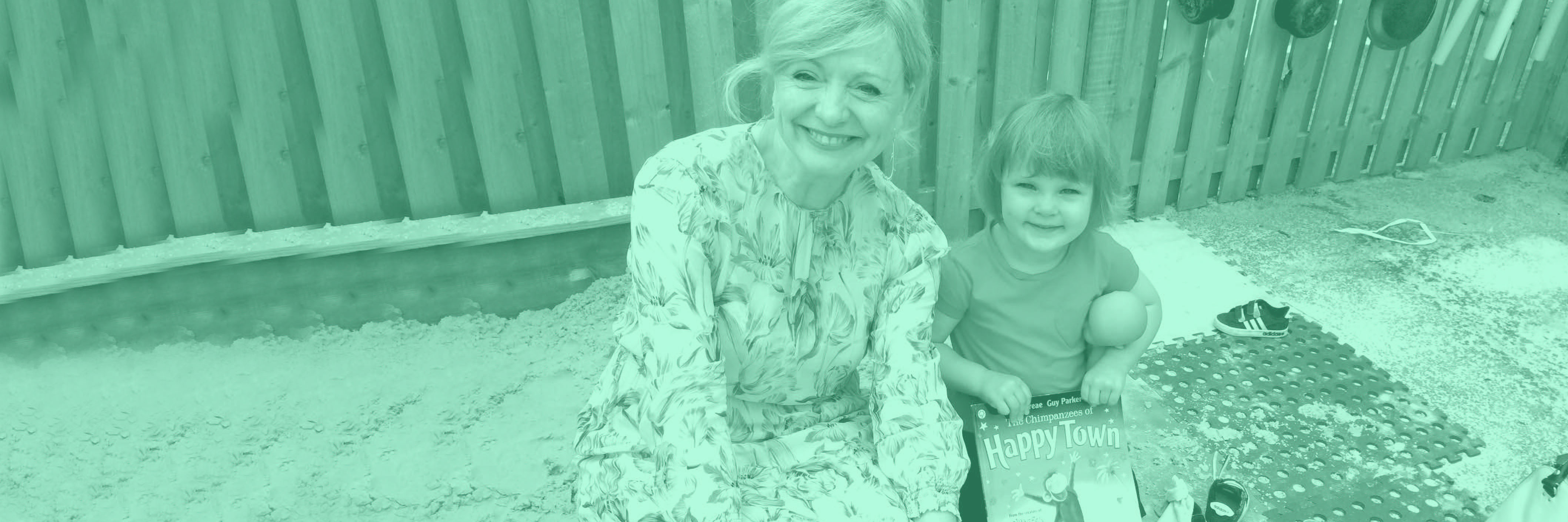 Tracy Brabin sitting with boy at edge of sand pit